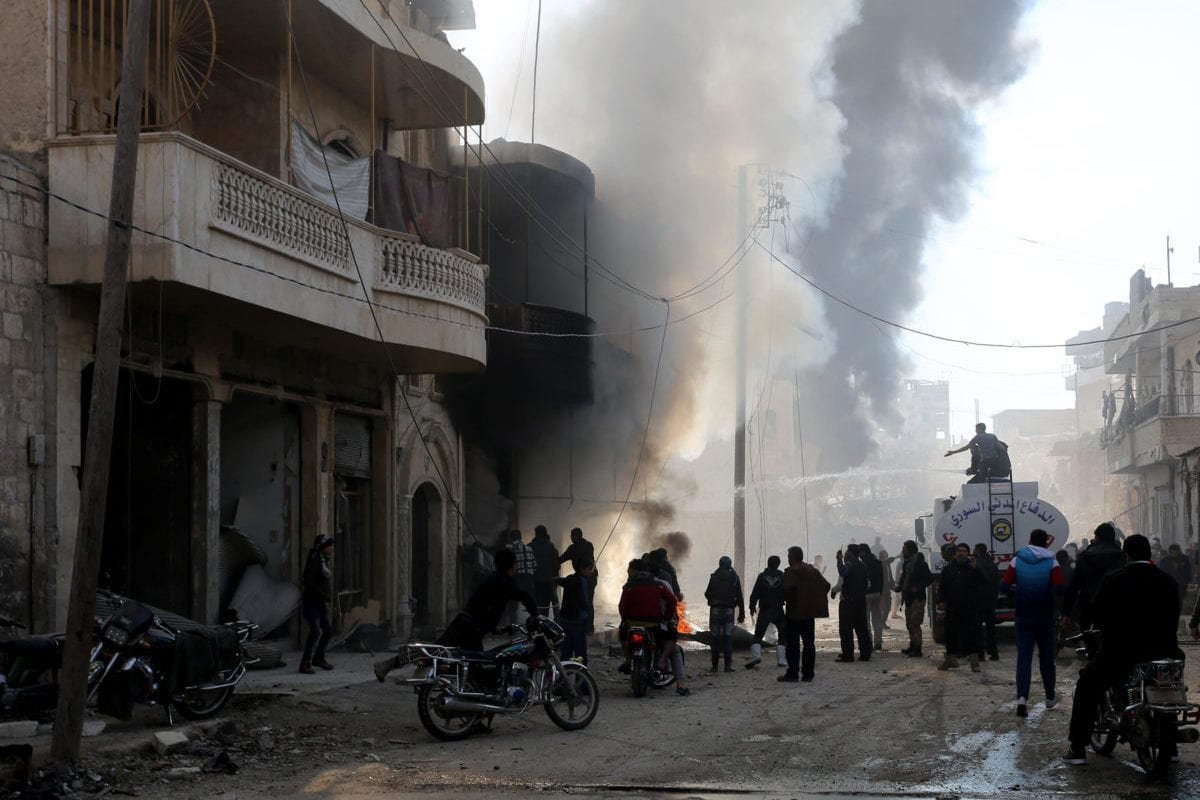 Civil Defence members try to extinguish the fire broke out after a plane belonging to the Assad Regime forces carried out airstrike over residential areas of Maarrat al-Nu'man district of Idlib, Syria on December 11, 2016 [Mouhamed karkas / Anadolu Agency]