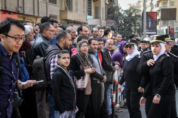People gather at the site after an explosion at Saint Mark's Coptic Orthodox Cathedral in Cairo, Egypt on December 11, 2016 [Ahmed Gamil / Anadolu Agency]