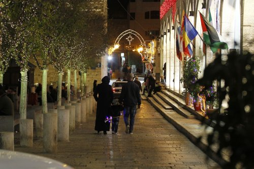 Streets and avenues near the Church of the Nativity are illuminated with Christmas lights in Bethlehem, West Bank on December 11 2016 [Wisam Hashlamoun / Anadolu Agency]