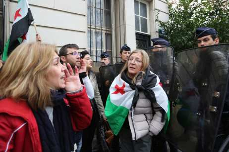 PARIS, FRANCE - DECEMBER 13: People shout slogans as they stage a protest, condemning massacres and attacks in Syria's Aleppo over civilians in front of Russian Embassy in Paris, France on December 13, 2016. ( Mustafa Sevgi - Anadolu Agency )
