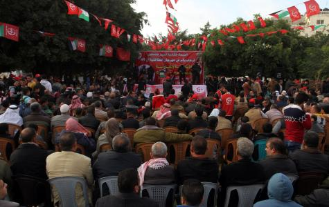 Palestinians gather to attend a rally marking the 49th anniversary of the founding of the Popular Front for the Liberation of Palestine (PFLP) in Rafah, Gaza on 13 December, 2016 [Abed Rahim Khatib/Anadolu Agency]