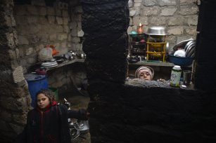 KHAN YUNIS, GAZA - DECEMBER 14: Palestinian children are seen at their house as Palestinians living in makeshift homes in El-Zohor neighborhood in the city of Khan Yunis on the Gaza Strip are facing difficult conditions under the cold weather on December 14, 2016. The economy and their living conditions are getting progressively worse due to Israel's embargo on Gaza. ( Mustafa Hassona - Anadolu Agency )