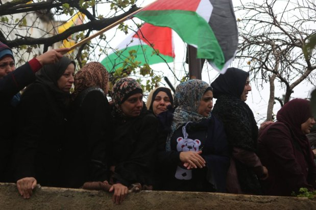 Palestinians attend a funeral ceremony held for Ahmad Hazim Ata al-Rimawi, 19, who was shot dead by Israeli soldiers in Beit Rima Town of Ramallah on December 18, 2016 in Ramallah, West Bank [Issam Rimawi / Anadolu Agency]