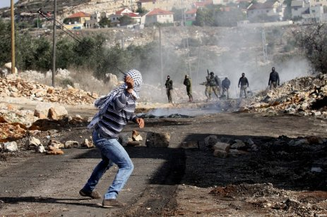 Palestinians clash with Israeli security forces during a protest against the nationalisation of the territories by Israeli government in Kafr Qaddum town of Nablus, West Bank on December 23, 2016 [Nedal Eshtayah / Anadolu Agency]
