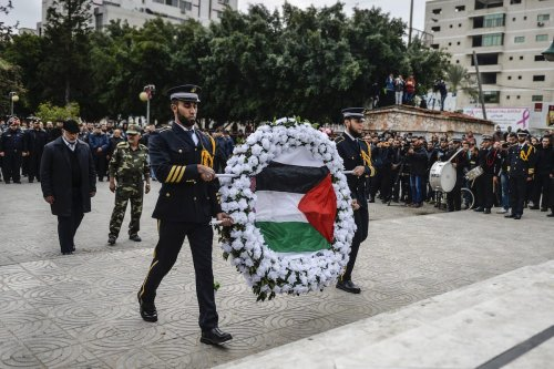 "GAZA CITY, GAZA - DECEMBER 28: Deputy Minister of Interior Affairs of Palestine, Tevfik Ebu Naim attends military parade marking the 8th anniversary of Israeli attack on Gaza Strip called ""Operation Cast Lead"", as soldiers carry a wreath in Gaza City, Gaza on December 28, 2016. ( Mustafa Hassona - Anadolu Agency )"