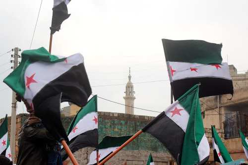 ALEPPO, SYRIA - DECEMBER 30 : Syrian people take part in a demonstration after Friday prayers as they demand from all opposition groups to come together in same roof, in Etarib district of Aleppo, Syria on December 30, 2016.