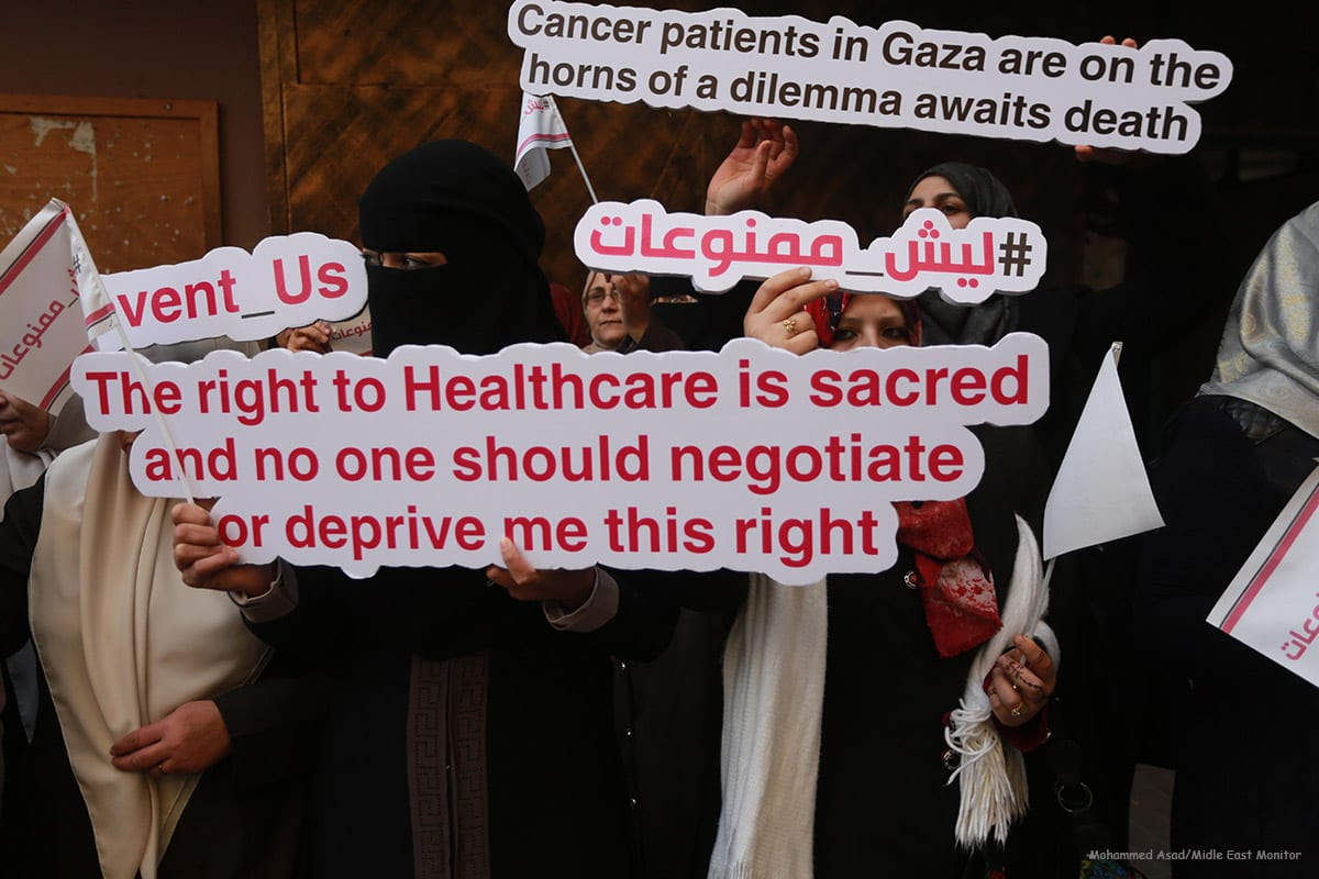 Palestinian cancer patients take part in a protest to demand travel for treatment as Israeli authorities often refuse [Mohammed Asad/Midle East Monitor]