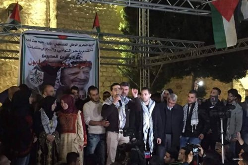 Mahmoud Balboul addresses crowds at the reception for him and his brother's in front of the Nativity Church in Bethlehem's Manger Square on 8th December 2016 [maannews]