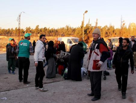 IDLIB, SYRIA: Evacuated civilians who fled from East Aleppo, which had been under siege by Assad regime forces, arrive at Sarmada town of Idlib, Syria on 15 December 2016 as part of a convoy, including buses and ambulances, departed from a crossing point between East and West Aleppo. [Bilal Baioush/Anadolu Agency]