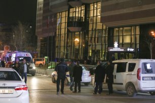 ANKARA, TURKEY: Turkish police take security measures in front of the building where Russian Ambassador to Turkey, Andrei Karlov has been shot and wounded in Ankara, Turkey on 19 December 2016. Karlov was delivering a speech at the opening ceremony of a photo exhibit when an armed assailant opened fire on him. The envoy died of his wounds. [Abdülhamid Hoşbaş/Anadolu Agency]
