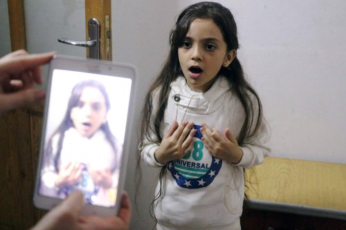 Syrian Bana al-Abed is filmed by her mother as they prepare to post on Twitter in English about life in the besieged eastern districts of Syria's Aleppo, on October 12, 2016 [AFP]