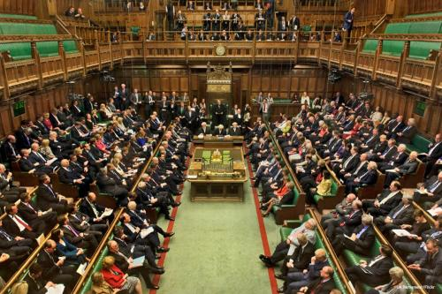 Image of British MP's debating in the House of Commons [UK Parliament/Flickr]