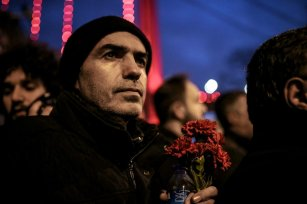 ISTANBUL, TURKEY - JANUARY 3: A man is seen with a carnation as he takes part in a protest against Istanbul nightclub terror attack in Istanbul, Turkey on January 3, 2017. An armed terrorist attack killed at least 39 people and injured 69 -- four of them critically -- at an Istanbul nightclub during the new year celebrations on early hours of 1st of January, 2017. ( Berk Özkan - Anadolu Agency )