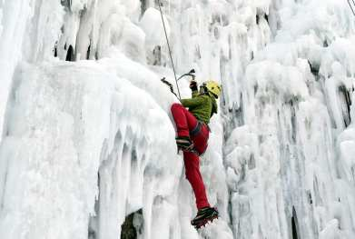 TEHRAN, IRAN - JANUARY 5: Iranian students of a Meygun ice climbing club use ice-axes and crampons to scale a frozen waterfall in the village of Meygun, 40km northeast of the capital Tehran in the Alborz mountain range on January 5, 2017. ( Fatemeh Bahrami - Anadolu Agency )