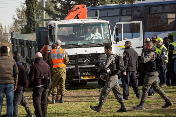 JERUSALEM: Officials examine the scene and take security measures after a truck rammed into Israeli soldiers in Jerusalem on 8 January 2017. Four soldiers were killed and a further 15 were injured. [Stringer/Anadolu Agency]