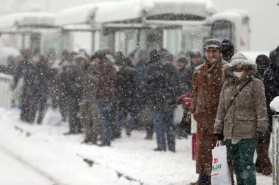 People are waiting for buses as heavy snowfall hits Istanbul, Turkey on January 9, 2017.