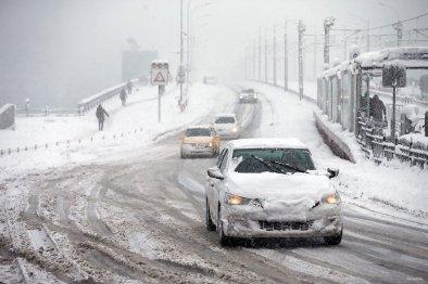 Cars try to make their way on Galata Bridge as heavy snowfall hits Istanbul, Turkey on January 9, 2017.