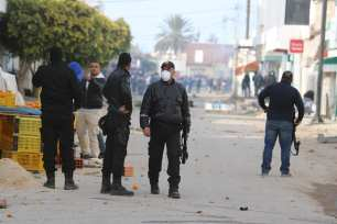 Police use tear gas to disperse the protesters demanding social rights to citizens and resolution of the crisis at Ras Jadir border crossing btween Libya and Tunisia, in Ben Gardane town of Medenine, Tunisia on January 11, 2017. ( Tasnim Nasri - Anadolu Agency )
