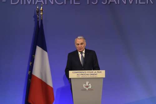French Foreign Minister Jean-Marc Ayrault delivers a speech during the opening session of Middle East peace talks about Israel-Palestinian territories' peace in Paris, France [Cem Özdel - Anadolu Agency]