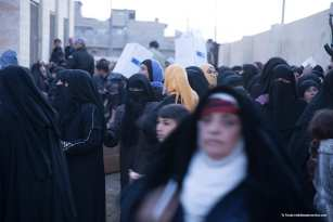 Shots from large artillery fire close by as women scramble for aid. Before ISIS, women wore the Hijab but now retain (under ISIS law) compulsory Niqab for fear of their return [Ty Faruk/middleeastmonitor.com]