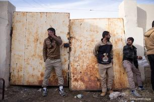 Aid workers stand exhausted from stopping hundreds of people storming a distribution centre [Ty Faruk/middleeastmonitor.com]