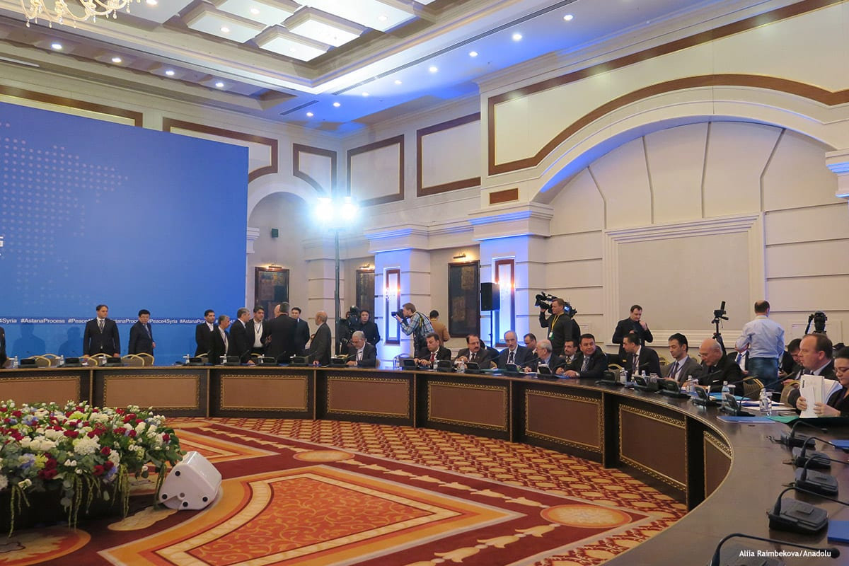 Representatives from the Syrian government and opposition delegates take part in the first session of Syria peace talks in Astana, Kazakhstan on January 23 2017 [Aliia Raimbekova/Anadolu]