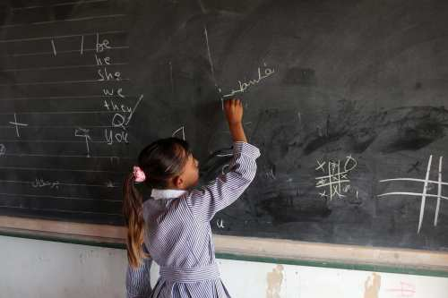 A Palestinian Bedouin Student learns at Arab Al-Ka'abneh school in Al-Mu'arrajat area near the occupied West Bank city of Jericho on 28 August 2016. [Shadi Hatem/Apa Images]