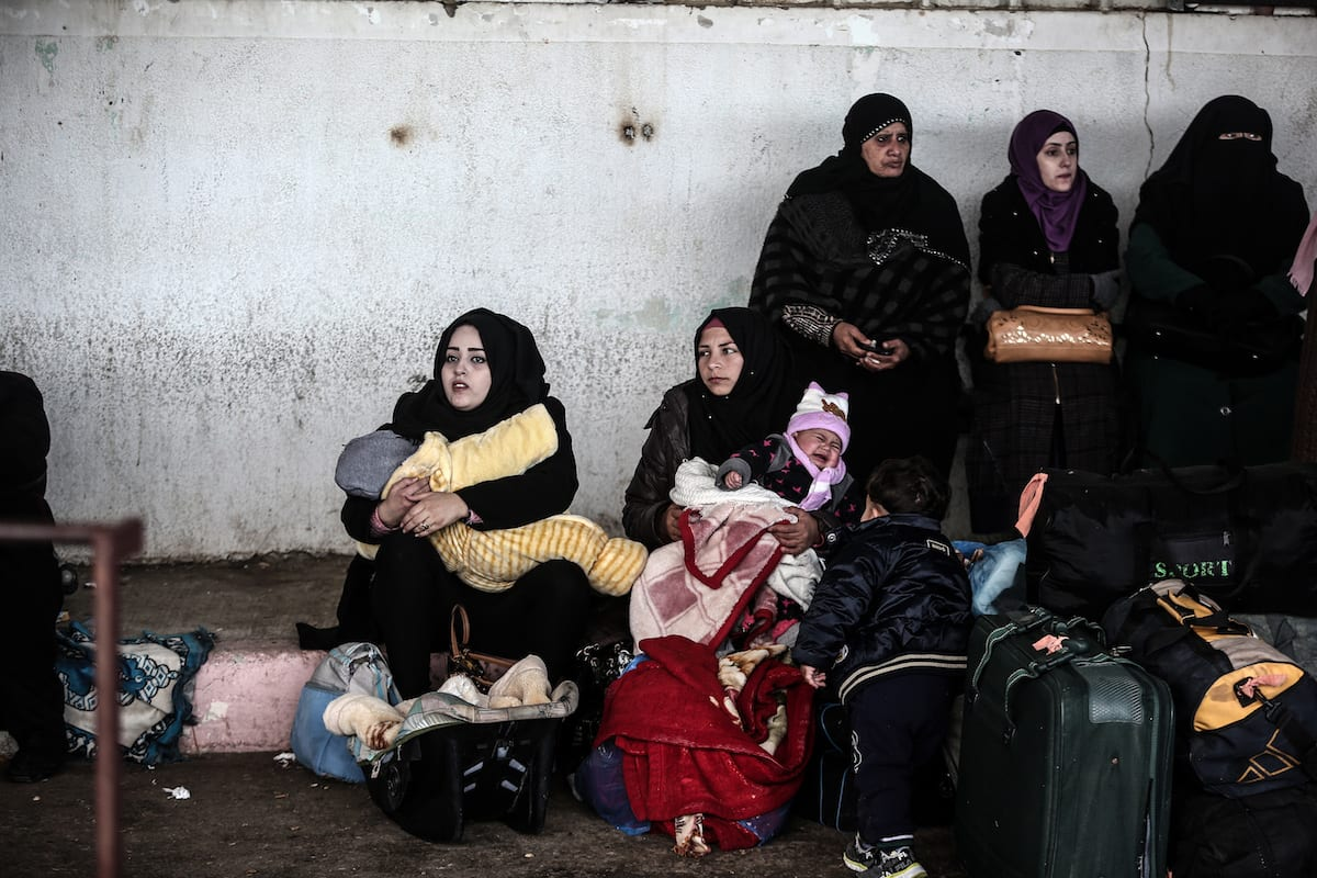 Palestinians wait for at the Rafah Border crossing after the gate temporarily reopened by Egyptian authorities in Rafah, Gaza on January 31 2017 [Ali Jadallah - Anadolu Agency]