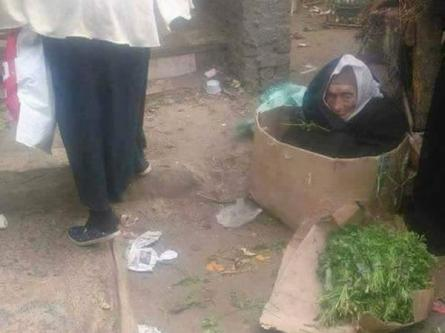 An 85-year old blind Egyptian woman living in a cardboard box selling vegetables