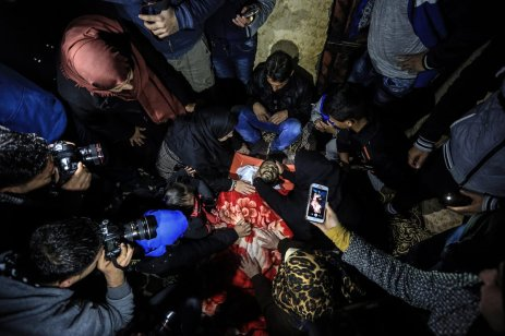 RAFAH, GAZA - FEBRUARY 09: (EDITORS NOTE: Image depicts death.) Palestinians mourn around the dead body of Muhammed Enver el-Akra (38), who was killed by Israeli forces, during a funeral ceremony in Rafah, Gaza on February 09, 2017. His dead body was brought from the Abu Yusuf Necar Hospital's morgue to his home in Sheikh Ridvan district of Gaza. ( Ali Jadallah - Anadolu Agency )