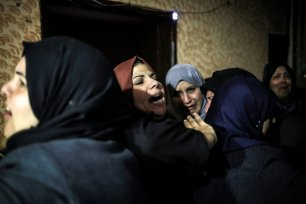 RAFAH, GAZA - FEBRUARY 09: Palestinians mourn after the death of Muhammed Enver el-Akra (38), who was killed by Israeli forces, during a funeral ceremony in Rafah, Gaza on February 09, 2017. His dead body was brought from the Abu Yusuf Necar Hospital's morgue to his home in Sheikh Ridvan district of Gaza. ( Ali Jadallah - Anadolu Agency )