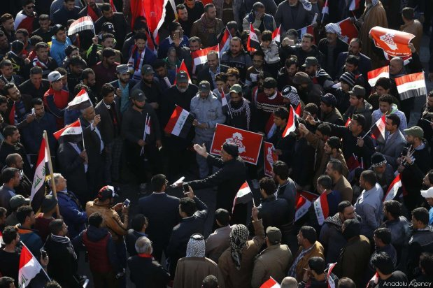 BAGHDAD, IRAQ - FEBRUARY 11: Thousands of supporters of Shia cleric Muqtada al-Sadr stage a protest to demand the dissolution of Iraq's High Electoral Commission at Tahrir Square in Baghdad, Iraq on February 11, 2017. ( Murtadha Sudani - Anadolu Agency )