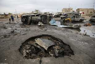BAGHDAD, IRAQ - FEBRUARY 17: Wreckage of cars are seen a day after a car bomb attack at al-Bayaa auto gallery in capital of Baghdad, Iraq on February 17, 2017. Many casualities reported after the attack. ( Murthadha Sudani - Anadolu Agency )