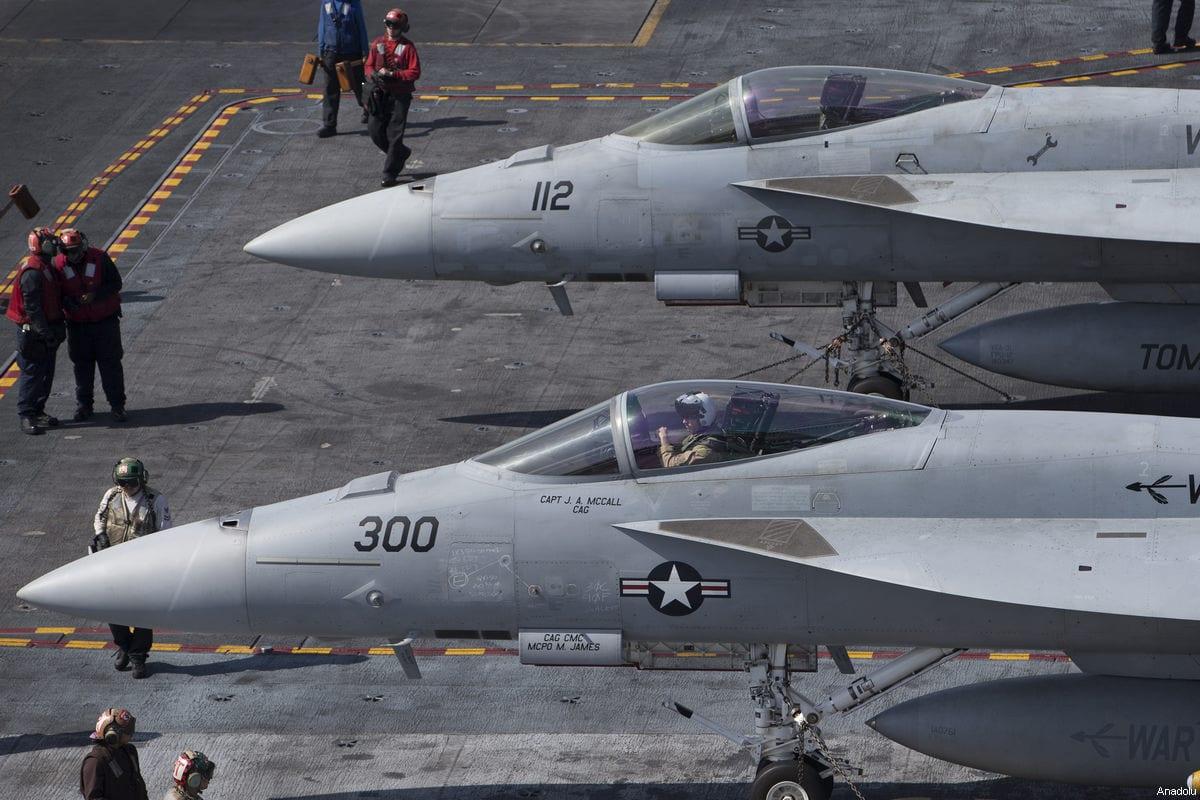 A pair of F16s on the US aircraft carrier USS George Washington [Murat Kaynak/Anadolu Agency]
