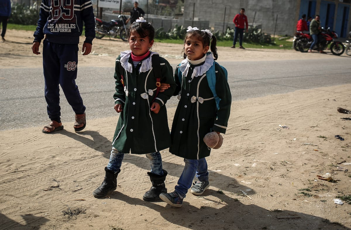 Palestinian students are seen after Israel carried out airstrikes near the primary school in Rafah, Gaza on 27 February 2017 [Ali Jadallah - Anadolu Agency]