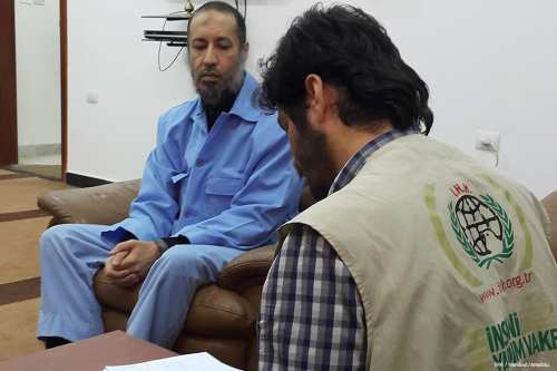 A member of the Foundation for Human Rights and Freedoms and Humanitarian Relief (IHH) meets with Saadi Gaddafi (L), late Libyan leader Muammar Gaddafi's son during their visit at Al-Hadba prison, in Tripoli, Libya on 23 February 2017 [IHH / Handout/Anadolu]