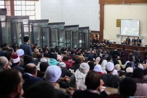 File photo from a trial against members of the Muslim Brotherhood taking place in Cairo, Egypt on 7 February 2017. The accused brotherhood members are seen inside the cage. [Moustafa Elshemy - Anadolu Agency]