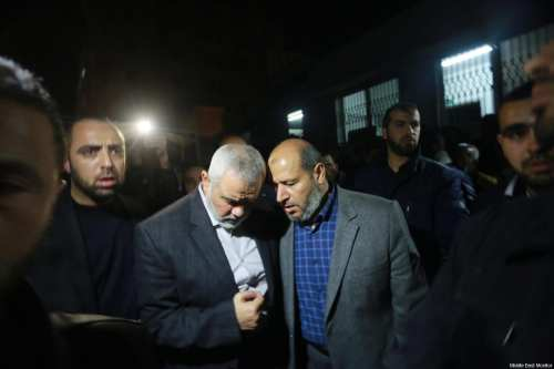 Hamas leaders Ismail Haniyeh (left) and Khalil Al-Haya (right) visiting the family of Mazen Fuqaha, a Hamas leader in Gaza assasinated by Israeli agents on March 24, 2017 [Mohammed Asad / Middle East Monitor]