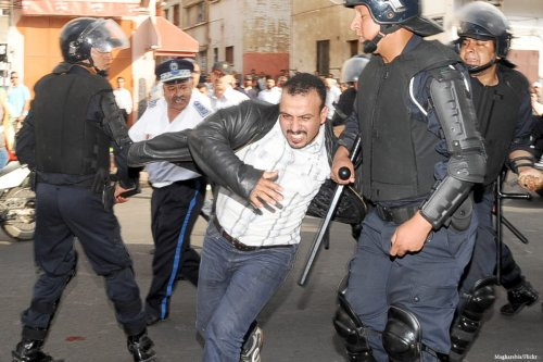 Image of Moroccan police intervening a protest in Morocco [Magharebia/Flickr]