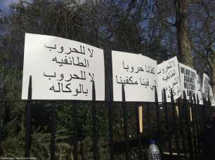 """In a protest against the creation of a UAE military base in Somalia, banners read """"No to sectarian wars, no to proxy wars"""" and """"We've had enough war, our problems are enough for us"""" outside the UAE embassy in London, UK, on 2 March 2017."""