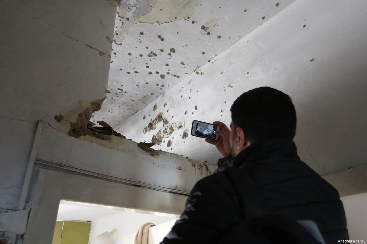 RAMALLAH, WEST BANK - MARCH 6: A man takes photos of bullet marks after Israeli soldiers stormed into and open fire on Basil Al-Araj's house, 31, in Ramallah, West Bank on March 6, 2017. After Israeli forces stormed into Israeli's houses Basil Al-Araj killed and 2 others injured. ( Issam Rimawi - Anadolu Agency )
