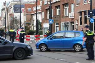 Dutch police officers block the road to the traffic in front of the Consulate General's residence of Turkey in Rotterdam before Turkish Minister of Family and Social Policies, Fatma Betul Sayan Kaya's travel to the Dutch city of Rotterdam by land, in Netherland on March 11, 2017 [Abdullah Aşıran / Anadolu Agency]