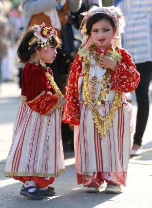 "Libyans wearing traditional clothes attend an event to mark the ""National Day of Traditional Dress"" at es-Suheda Square in Tripoli, Libya on March 13, 2017 ( Hazem Turkia/Anadolu )"