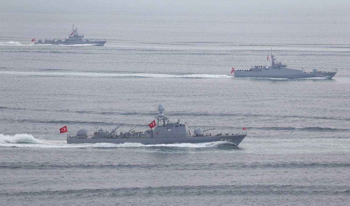 Frigates belonging to the Turkish Navy pass through the Canakkale Strait during the rehearsals of the ceremony which will be held for the 102nd Anniversary of Canakkale Victory, at Gallipoli Peninsula in Canakkale, Turkey on 16 March, 2017 [Ali Atmaca/Anadolu Agency]