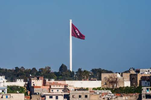 TUNIS, TUNISIA - MARCH 20: A Tunisian flag is raised up to the highest flagpole on the 61st anniversary of Tunisia's independence during a ceremony at Belvedere Park in Tunis, Tunisia on March 20, 2017 ( Amine Landoulsi - Anadolu Agency )