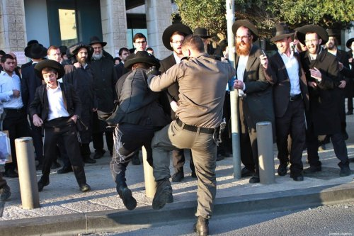 JERUSALEM: Israeli police assault Ultra Orthodox Jewish protesters during a demonstration against compulsory military service on 20 March 2017. [Gil Cohen Magen/Anadolu Agency]