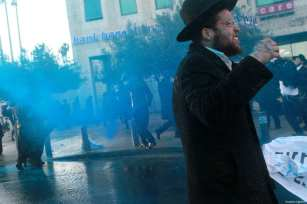JERUSALEM: Israeli police use water canons to disperse Ultra Orthodox Jewish protesters during a demonstration against compulsory military service on 20 March 2017. [Gil Cohen Magen/Anadolu Agency]