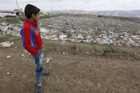 A Syrian boy stands near the garbage dump at a Syrian refugee camp in Beirut, Lebanon on March 21, 2017 (Ratib Al Safadi - Anadolu Agency )