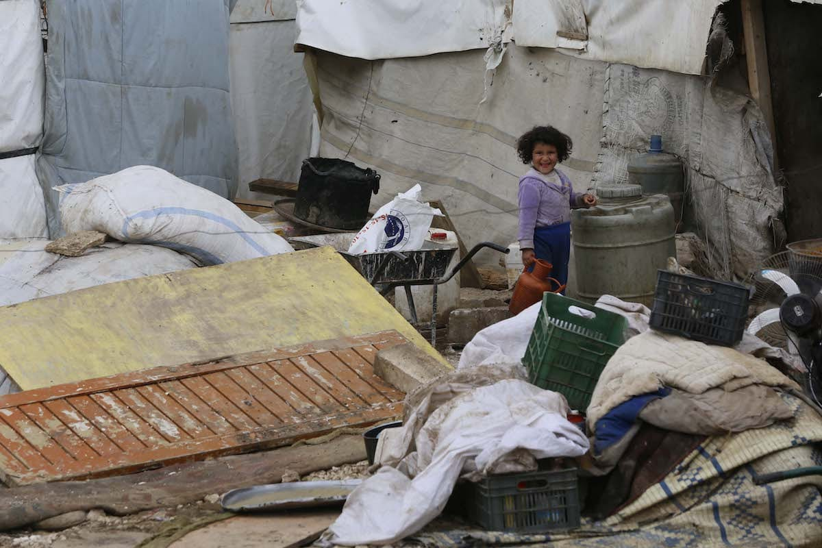 Death toll of Syrians found on border rises to 15