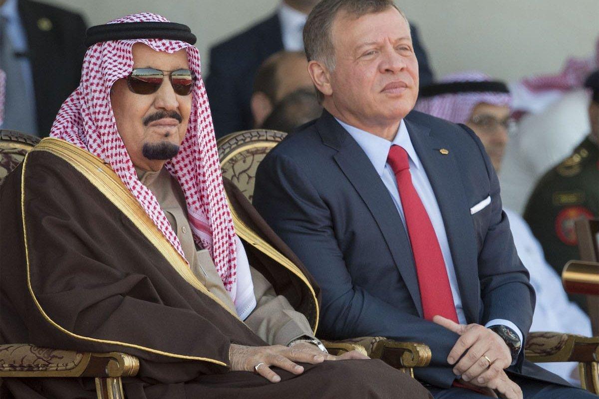 Saudi Arabia's King Salman bin Abdulaziz Al Saud (L) and King Abdullah II (R) watch the military parade in Amman, Jordan on 28 March, 2017 [Bandar Algaloud/Saudi Kingdom Council Handout/Anadolu Agency]